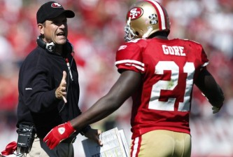 San Francisco 49ers head coach  Harbaugh congratulates running back Gore after a touchdown during their NFL football game against the Tampa Bay Buccaneers in San Francisco